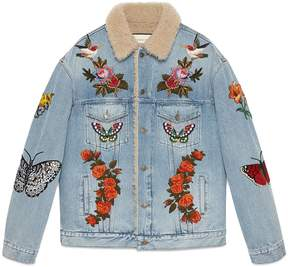 Embroidered denim jacket with shearling
