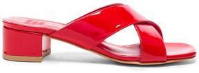 Maryam Nassir Zadeh Patent Leather Lauren Slide Heels in Red.