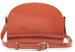 A.P.C. Half Moon Patent Leather Cross Body Bag - Womens - Orange