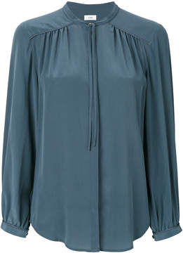 Closed collarless blouse