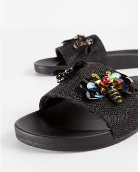 Express embellished bug slides