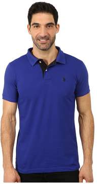 U.S. Polo Assn. Slim Fit Solid Pique Polo with Contrast Color Striped Under-Collar Men's Short Sleeve Pullover