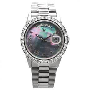 Rolex Day-Date gold watch