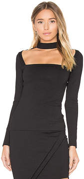 Donna Mizani Long Sleeve Cut Out Mock Neck Top