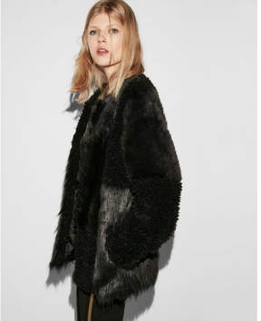 Express collarless pieced faux fur coat
