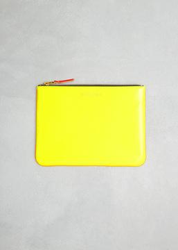 Comme des Garcons WALLET yellow / orange super fluo leather line zip pouch
