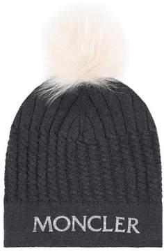 Moncler Woollen hat with a fur bobble
