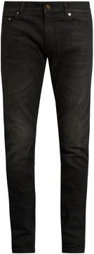 SAINT LAURENT Skinny-leg faded jeans