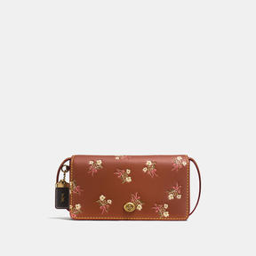COACH DINKY IN GLOVETANNED LEATHER WITH FLORAL BOW PRINT - BRASS/1941 SADDLE