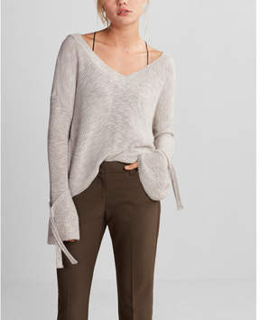 Express tie sleeve split back cropped sweater