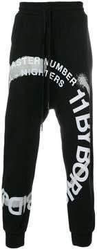 11 By Boris Bidjan Saberi printed logo track pants