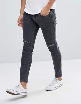 MANGO Man Skinny Jeans With Rips In Washed Black