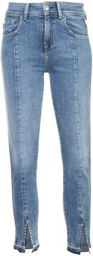 7 For All Mankind faded jeans with ankle slits