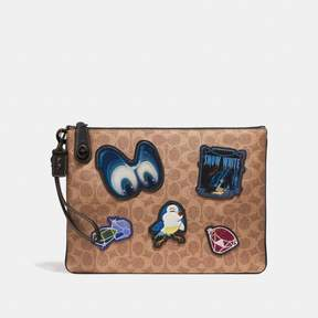 COACH COACH DISNEY X TURNLOCK WRISTLET 30 IN SIGNATURE PATCHWORK - TAN/BLACK/BLACK COPPER