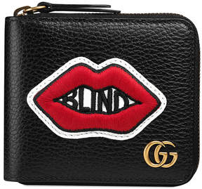 Gucci Leather coin wallet with mouth embroidery
