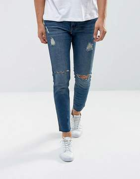 MANGO Man Ripped Skinny Jeans With Raw Hem In Mid Wash