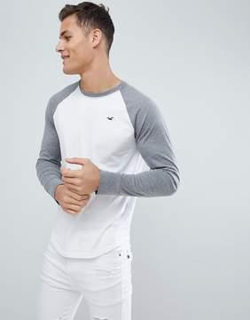 Hollister Long Sleeve Top Raglan Baseball Icon Logo Slim Fit in White