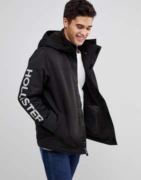 Hollister Fleece Lined Jacket Hooded Sleeve Logo in Black