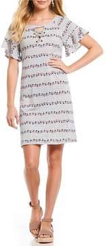 Democracy Raglan Ruffle Sleeve Lace-Up Neck Tennis Dress