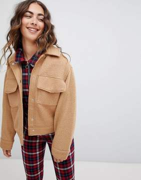 Monki textured short jacket with oversized pockets in beige