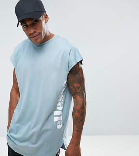 Ellesse Curved Hem T-shirt With Side Logo In Blue