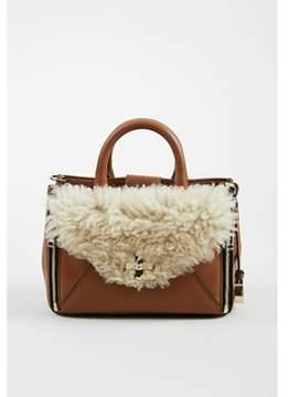 Diane von Furstenberg Pre-owned tobacco Brown Leather Shearling Mini Secret Agent Bag.