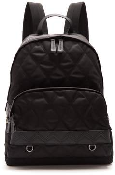 Prada Leather-trimmed zip-around quilted backpack