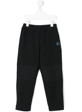 Young Versace track pants with knee panels