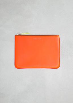 Comme des Garcons WALLET orange / pink super fluo leather line zip pouch