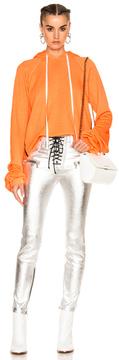 Unravel for FWRD Cropped Oversized Sleeve Hoodie in Neon,Orange.