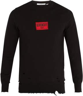 Givenchy Distressed cotton-blend sweatshirt