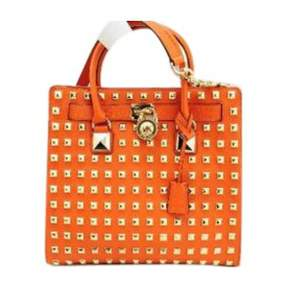 MICHAEL Michael Kors Orange Leather Travel Bag