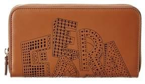 Salvatore Ferragamo Laser Cut Leather Zip Around Wallet.