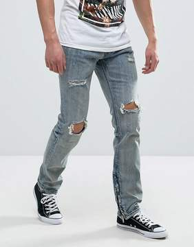 Reason Jeans In Light Wash With Distressing