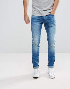 Celio Slim Fit Jeans In Mid Wash Blue With Distressing