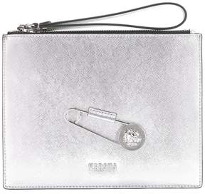 Versus oversized pin clutch
