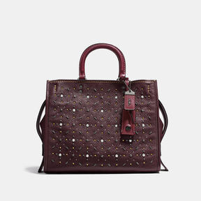 COACH Coach Rogue In Natural Pebble Leather With Prairie Rivets - BLACK COPPER/OXBLOOD - STYLE