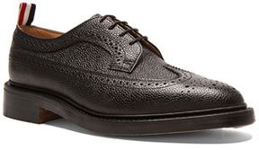 Thom Browne Classic Long Leather Wingtips in Black.