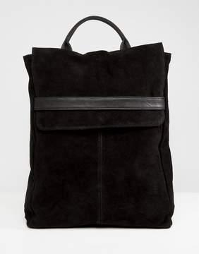 Asos DESIGN Suede Belted Flap Backpack
