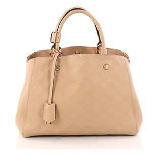 Louis Vuitton Pre-owned: Montaigne Handbag Monogram Empreinte Leather Mm.
