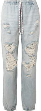 Alexander Wang Distressed Low-rise Tapered Jeans - Light denim