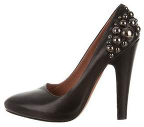 Alaia Stud Embellished Leather Pumps