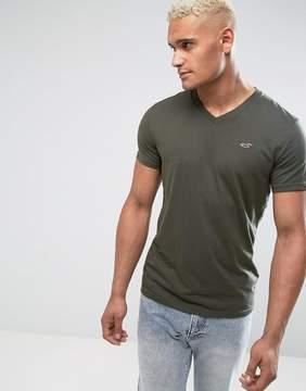 Hollister V-Neck T-Shirt Slim Fit Icon Logo in Olive