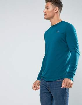 Hollister Long Sleeve Top Crew Icon Logo Slim Fit in Teal