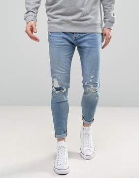 Pull&Bear Carrot Fit Jeans With Rips In Light Wash