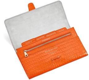 Aspinal of London Classic Travel Wallet In Deep Shine Amber Small Croc