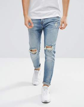 Pull&Bear Ripped Jeans In Carrot Fit In Mid Wash Blue