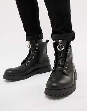 Asos DESIGN lace up boots in black leather with metal detail