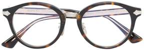 Gucci embossed titanium round glasses