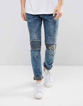 Religion Biker Jeans With Rip Repair Knee Detail In Skinny Fit With Stretch In Opium Wash Blue